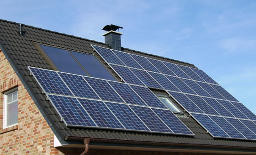 Solar panels covering the roof of a house
