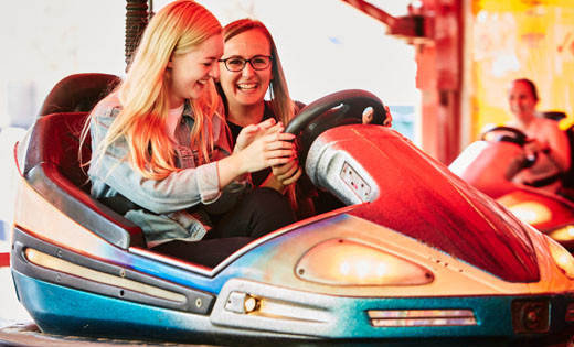 It was all smiles on the dodgems! July 2019