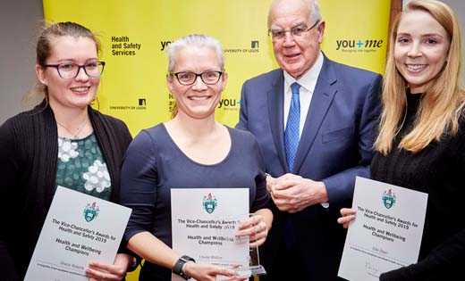 Sir Alan Langlands, Vice-Chancellor, presents the Health and Wellbeing Champions Award to Grace Roberts, Louise Walton and Ellie Dean for their role in the Couch to 5K initiative. December 2019