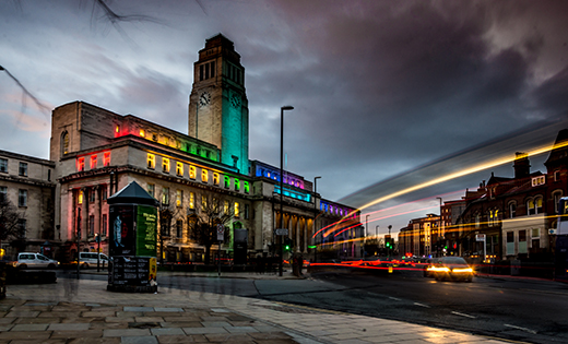 A picture of the Parkinson Building, lit up in rainbow colours. July 2020.