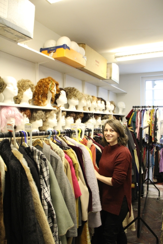 Allana among the costumes in the PCI store.